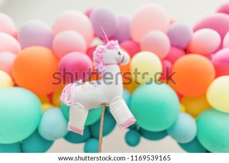 Unicorn and balloons