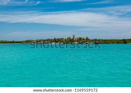 Contoy island (Quintana Roo), Mexico, 08.21.2018: view of the coast sailing around the island in the caribbean sea. #1169559172