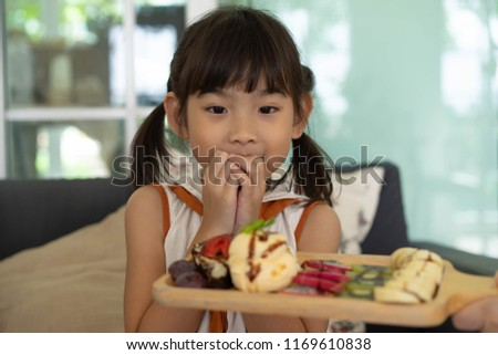 Portrait child Cute little girl Asian face eat Ice cream In the coffee shop #1169610838