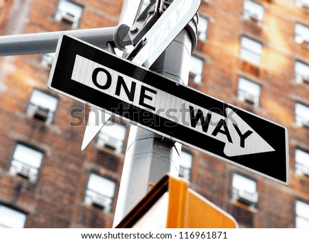 """one way"" sign on pole in street in u.s.a."