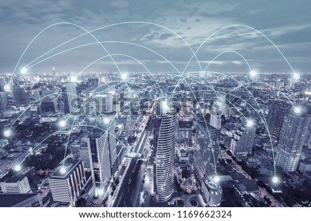 Network connection activity in the modern city skyscraper technology in blue tone illustration concept. #1169662324