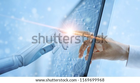 Hands of robot and human touching on global virtual network connection future interface. Artificial intelligence technology concept.  #1169699968