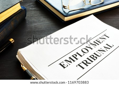 Employment tribunal documents, note pad and glasses. Royalty-Free Stock Photo #1169703883