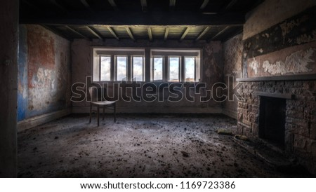Old ruined abandoned house with a haunting atmosphere #1169723386