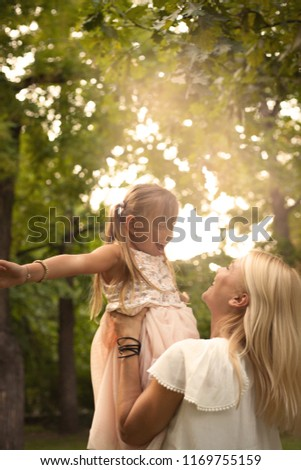 Young mother and daughter having fun together. #1169755159