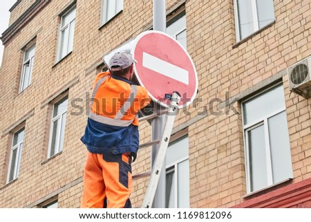 Krasnoyarsk, Russia - August 31, 2018:  installation of the new prohibition sign down the street Lenina. On the person there is no focus a little #1169812096