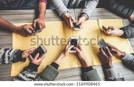 Group of friends having fun with smartphones - Closeup of hands social networking with mobile cellphones - Wifi connected people, technology, millennial and z generation concept #1169908465