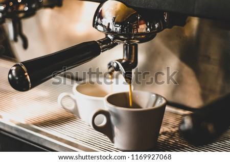 Close-up of espresso pouring from coffee machine. Professional coffee brewing #1169927068