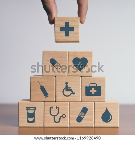 Concept of Insurance for your health, Hand hold wooden block with icon healthcare medical #1169928490