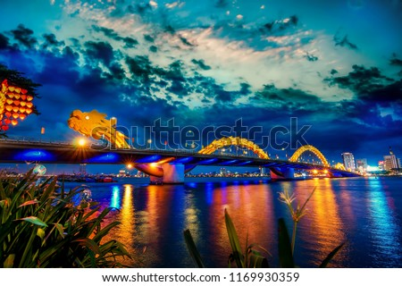 Da Nang, Vietnam: Dragon bridge at sunset which is considered as the icon of Da Nang city.                              #1169930359