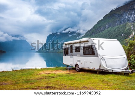 Family vacation travel RV, holiday trip in motorhome, Caravan car Vacation. Beautiful Nature Norway natural landscape. #1169945092
