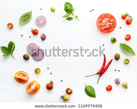 The ingredients for homemade pizza on white wooden background. #1169974408