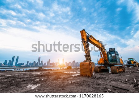 excavator in construction site on sunset sky background #1170028165