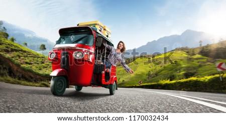 Happy woman travel by traditional srilankan transport, road near tea plantation in srilanka #1170032434