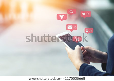 Close up of woman using his mobile smartphone outdoor. Shopping online concept. #1170035668