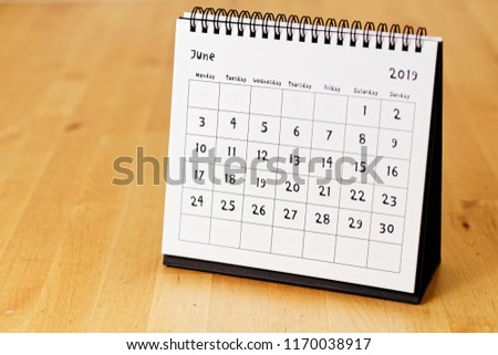 Month page: June in 2019 paper calendar with funny font on the wooden table #1170038917