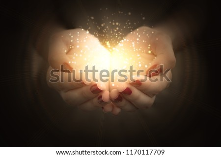 magic particles on the palms of a woman, a stream of magical energy emanating from female hands #1170117709