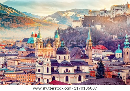 Salzburg, Austria, Europe. City in Alps of Mozart birth.  Panoramic view of Salzburg skyline with Festung Hohensalzburg and in autumn. Famous town and popular international travel destination. #1170136087