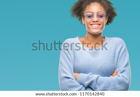 Young afro american woman wearing glasses over isolated background happy face smiling with crossed arms looking at the camera. Positive person. #1170142840