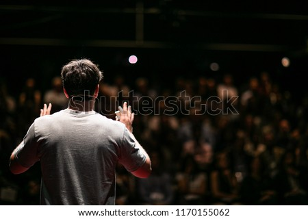 Speaker giving a talk on corporate Business Conference. Audience at the conference hall. Business and Entrepreneurship event. Royalty-Free Stock Photo #1170155062