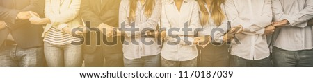 Creative team meeting hands together in line. Young business people are holding hands. Unity and teamwork concept.  Royalty-Free Stock Photo #1170187039
