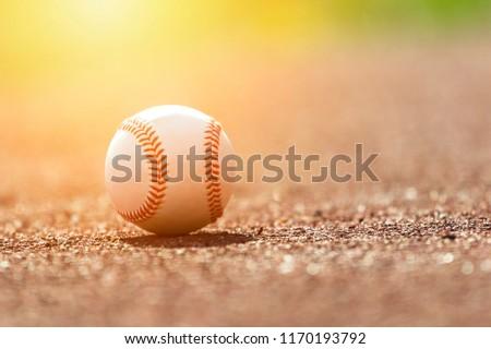 Baseball ball on pitchers mound. Baseball field at sunset #1170193792