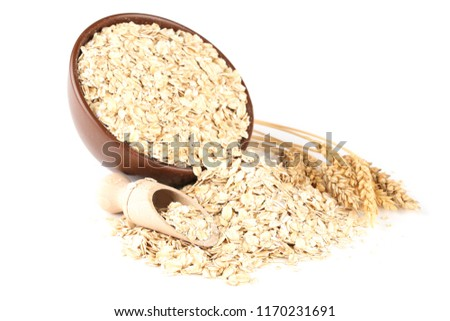 Oatmeal in bowl isolated on white background #1170231691