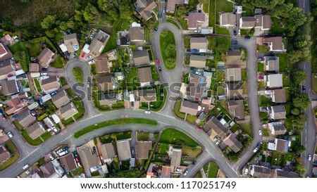 Top down aerial view of urban houses and streets in a residential area of a Welsh town #1170251749