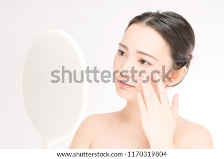 Young asian woman worrying about her skin. #1170319804