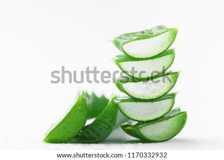 Aloe vera leaf slices with gel on white background. #1170332932