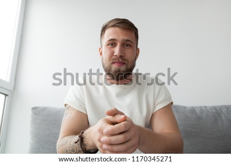 Portrait of happy millennial man making video call on laptop sitting on couch at home, young mentor or trainer record online webinar or training, male communicate or broadcast live on computer Royalty-Free Stock Photo #1170345271