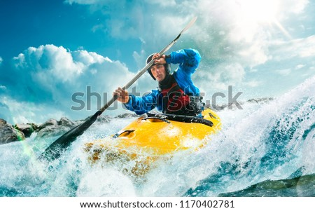 Whitewater kayaking, extreme kayaking. A guy in a kayak sails on a mountain river #1170402781