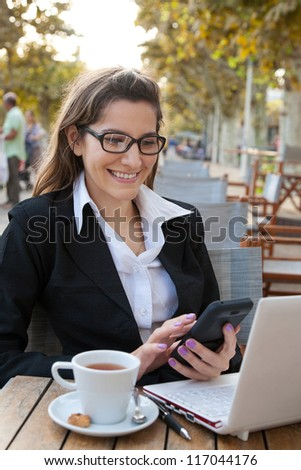 Businesswoman working in the outdoor cafe #117044176