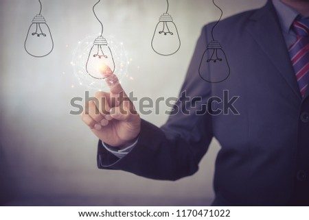 new idea creative idea.Concept of idea and innovation.Hand touch Light bulb #1170471022
