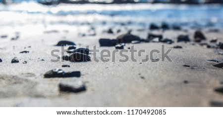 small rock on the sand beach by the sea  #1170492085