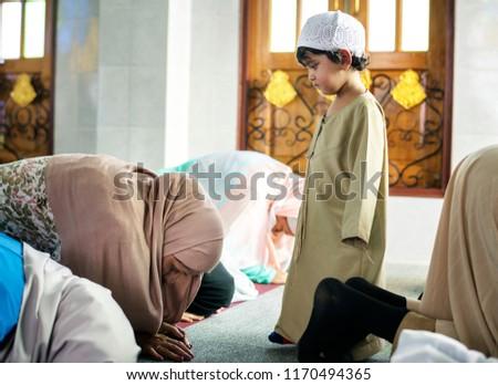 Muslim people praying in Sujud posture #1170494365