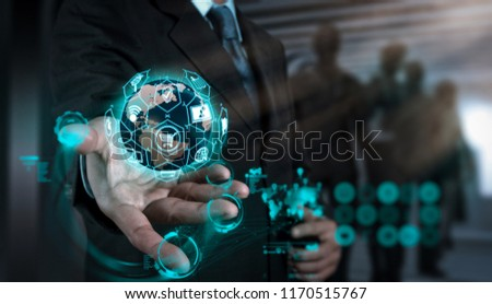 E-commerce concept with VR digital interface with icons of shopping cart and delivery truck and credit card with symbol of online purchase on internet.businessman working with new modern computer #1170515767