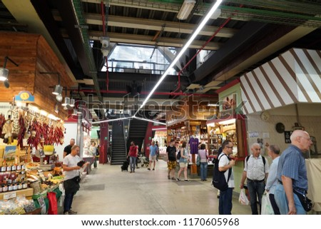 FLORENCE, ITALY - SEPTEMBER 1 2018 - People buying at old city market traditional shops that give food artisans centre stage. #1170605968