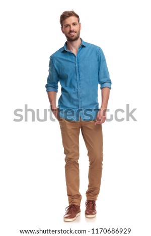 full body picture of a casual man with hand in pocket on white background