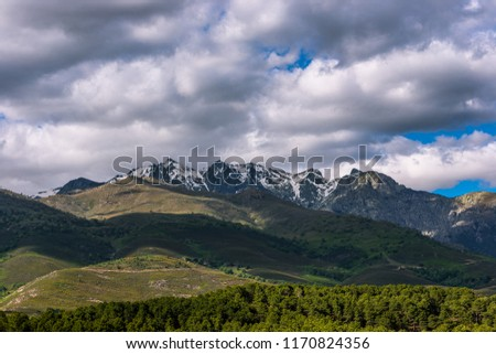 Sierra De Gredos, Spain. Mountains with snow and white clouds #1170824356