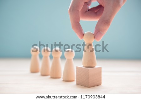 Successful team leader, Businessman hand choose people standing out from the crowd. #1170903844