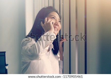Young working woman calling phone talking discussing the business meeting , connections communication concept, happy dueling #1170905461