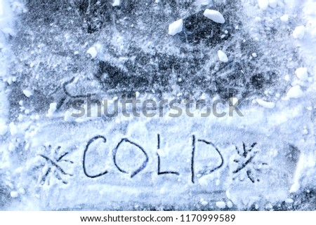 COLD inscription at the bottom of the image, the snow and ice background #1170999589