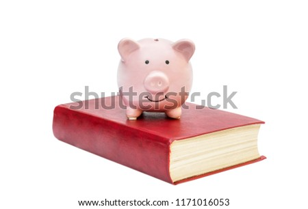 Piggy bank with red book on white. Savings for education. #1171016053