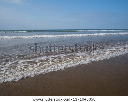 The beautiful waves roll in on the North Devon coast at Westward Ho , England Royalty-Free Stock Photo #1171045858