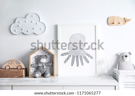 Scandinavian newbornbaby shelf  with mock up photo frame, wooden accessories and toys, teddy bears and cloud. White and cozy childroom.  #1171065277