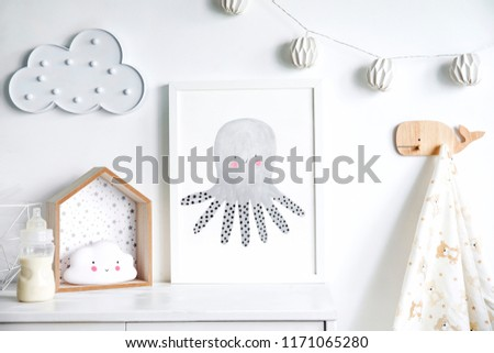 Stylish scandinavian nursery shelf with mock up photo frame, bottle with milk and toys. Modern interior with white walls and wooden accessories. #1171065280