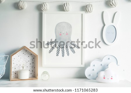 The modern scandinavian newborn baby room with mock up poster frame, white clouds, cotton lamps and mirror. Sunny and bright interior. #1171065283