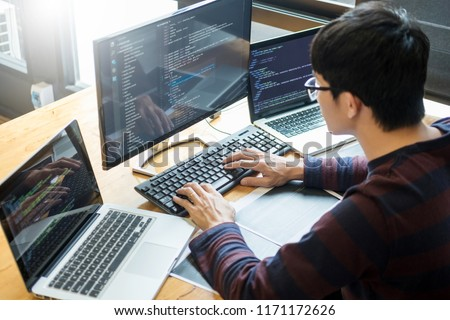Pensive programmer working on on desktop pc programming code technologies or website design at office Software Development Company.  #1171172626