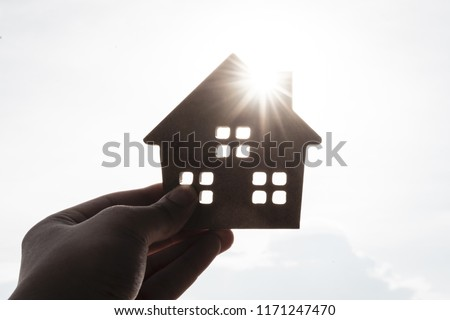 House model in home insurance broker agent 's hand or in salesman person with sky background. Real estate agent offer house, property insurance and security, affordable housing concepts #1171247470